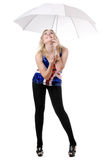 Young woman posing under umbrella Stock Photo