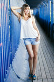 Young woman posing wall background Royalty Free Stock Image