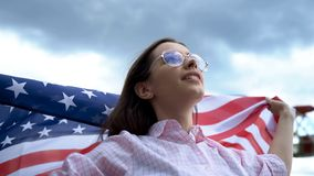 Young woman posing and waving USA flag, Independence Day Celebration, patriot. Stock photo royalty free stock photography