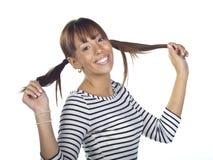 Young woman posing wearing a striped shirt Stock Photography