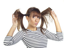 Young woman posing wearing a striped shirt Stock Images
