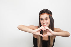 Young woman posing on a white background doing a heart Royalty Free Stock Photos