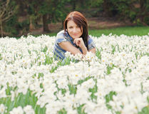 Young woman posing with white daffodils Stock Photography