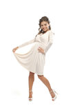 A young woman posing in a white dress Stock Photography
