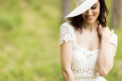 Young woman posing in a white dress with a hat Royalty Free Stock Photo