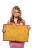 Young woman posing with yellow board Stock Image