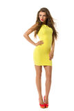 Young Woman Posing In Yellow Fitted Mini Dress Stock Images