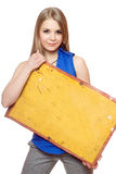 Young woman posing with yellow vintage board Stock Photos