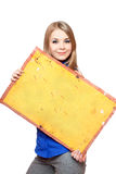 Young woman posing with yellow vintage board Stock Image