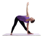 Young woman posing in yoga asana on rubber mat Stock Image