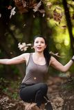Young Woman with Positive Energy and Beautiful Smile posing in t. He forest... Autumn and Winter colors Royalty Free Stock Image