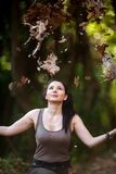 Young Woman with Positive Energy and Beautiful Smile posing in t. He forest... Autumn and Winter colors Stock Image