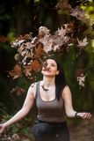 Young Woman with Positive Energy and Beautiful Smile posing in t. He forest... Autumn and Winter colors Royalty Free Stock Images