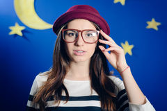 Young woman in pot hat with paper moon and stars Stock Photo