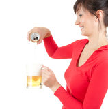 Young woman pouring beer to the mug Royalty Free Stock Photo