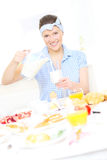 Young woman pouring milk Stock Photography
