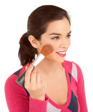 Young Woman Powdering her Cheek Stock Photo