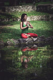 Young woman practice yoga outdoor Royalty Free Stock Image