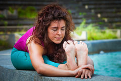 Young woman practice yoga  outdoor Stock Images