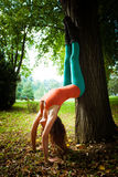 Young woman practice yoga outdoor Stock Photography