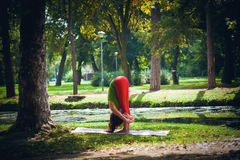 Young woman practice yoga outdoor Stock Image