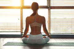 Free Young Woman Practices Yoga At Gym By Window Royalty Free Stock Photos - 135879888