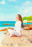 Young woman practices yoga on the beach Royalty Free Stock Photos