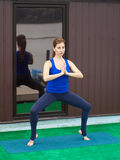 Young woman practicing advanced yoga fitness workout 23 Royalty Free Stock Images