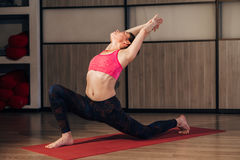Young woman practicing advanced yoga royalty free stock image