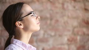 Young woman practicing breathing fresh air exercises, taking deep breath