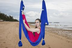 Young woman practicing fly yoga asana outdoors. Health, sport, yoga concept royalty free stock photography