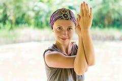 Young woman practicing garudasana Royalty Free Stock Image