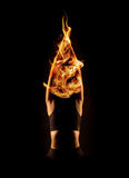 Young woman practicing hot yoga. Abstract yoga woman with fire. Abstract hot yoga Stock Image