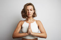 Young woman practicing meditation at the office, online yoga classes, taking a break time for a minute. Stock Photography