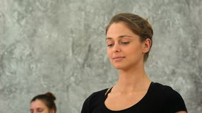 Young woman practicing meditation at yoga class stock video