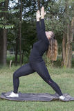 Young woman practicing pilates in nature Stock Images