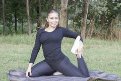 Young woman practicing pilates in nature Stock Photo