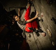Young woman practicing rock-climbing Royalty Free Stock Images