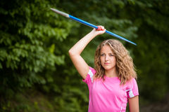 Young woman practicing throwing a javelin Royalty Free Stock Image