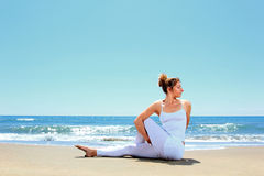Young woman practicing yoga. On the beach Royalty Free Stock Image