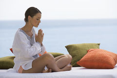 A young woman practicing yoga Royalty Free Stock Photo