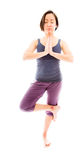 Young woman practicing yoga. Young adult caucasian woman isolated on a white background Stock Photography