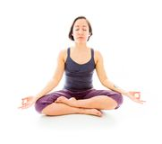Young woman practicing yoga. Young adult caucasian woman isolated on a white background Royalty Free Stock Photography