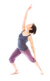 Young woman practicing yoga. Young adult caucasian woman isolated on a white background Royalty Free Stock Images