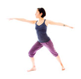 Young woman practicing yoga. Young adult caucasian woman isolated on a white background Stock Photos