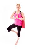 Young woman practicing yoga. Young adult caucasian woman isolated on a white background Royalty Free Stock Photos