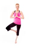 Young woman practicing yoga. Young adult caucasian woman isolated on a white background Royalty Free Stock Photo