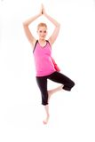 Young woman practicing yoga. Young adult caucasian woman isolated on a white background Stock Image