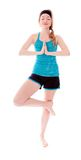Young woman practicing yoga. Attractive young woman shot in studio and isolated on a white background Royalty Free Stock Photos