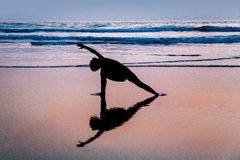 Young woman practicing yoga on beach in Agonda Royalty Free Stock Photos